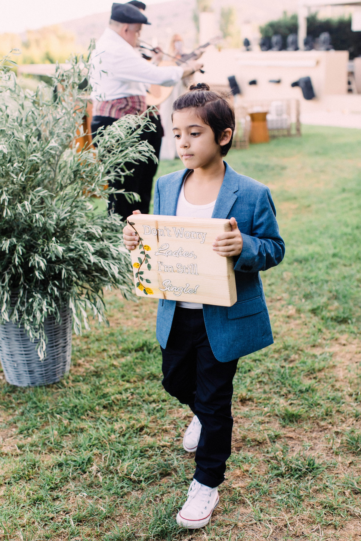 boy holding sign