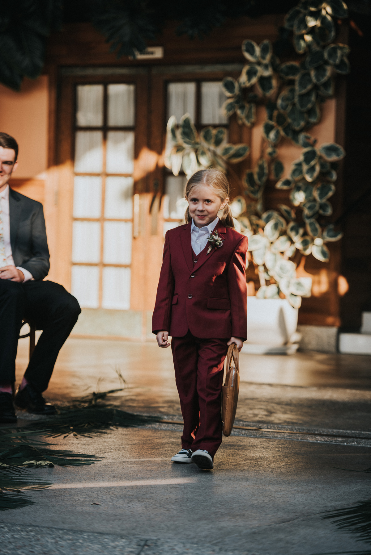 flower girl in suit