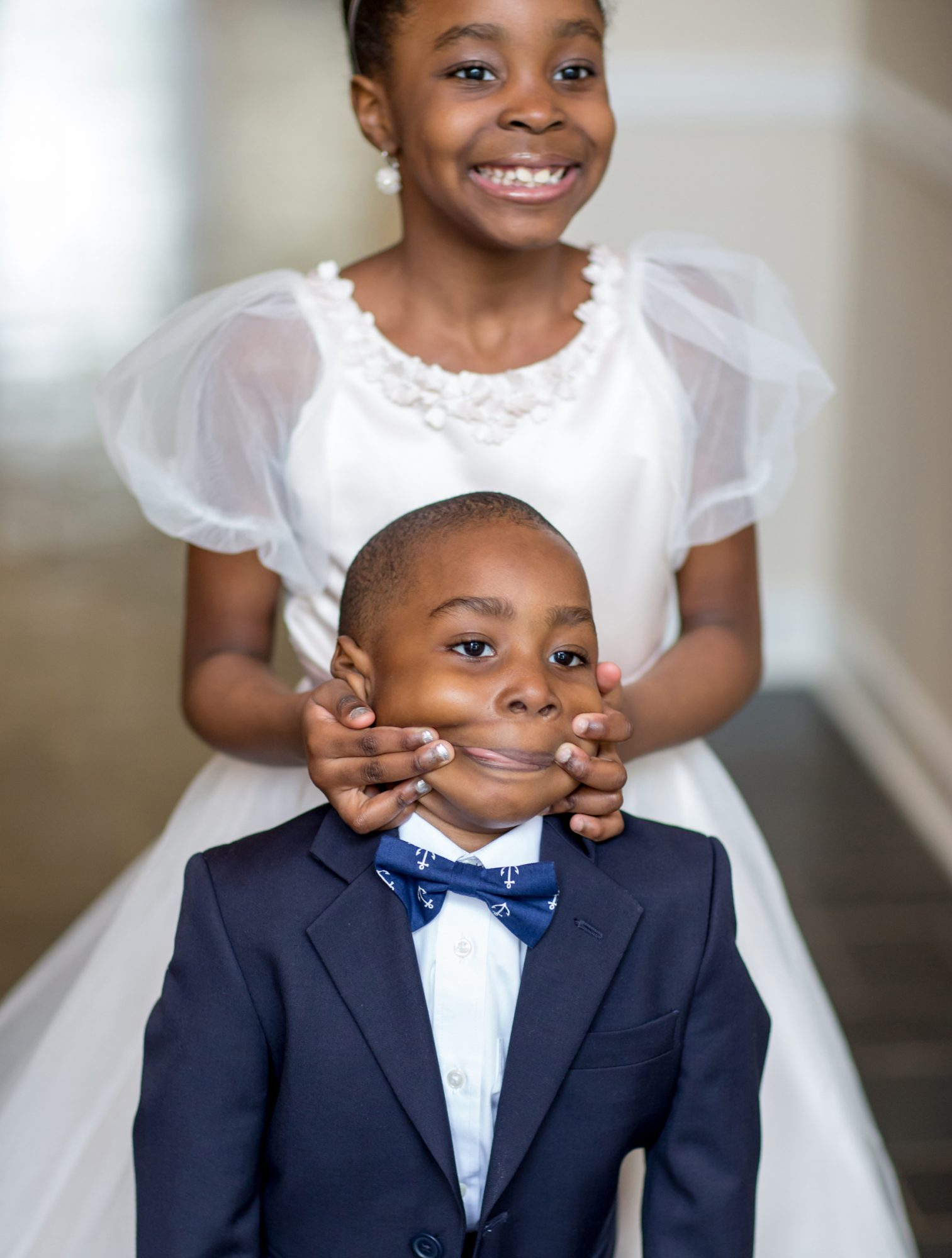 flower girl and ring bearer making funny face