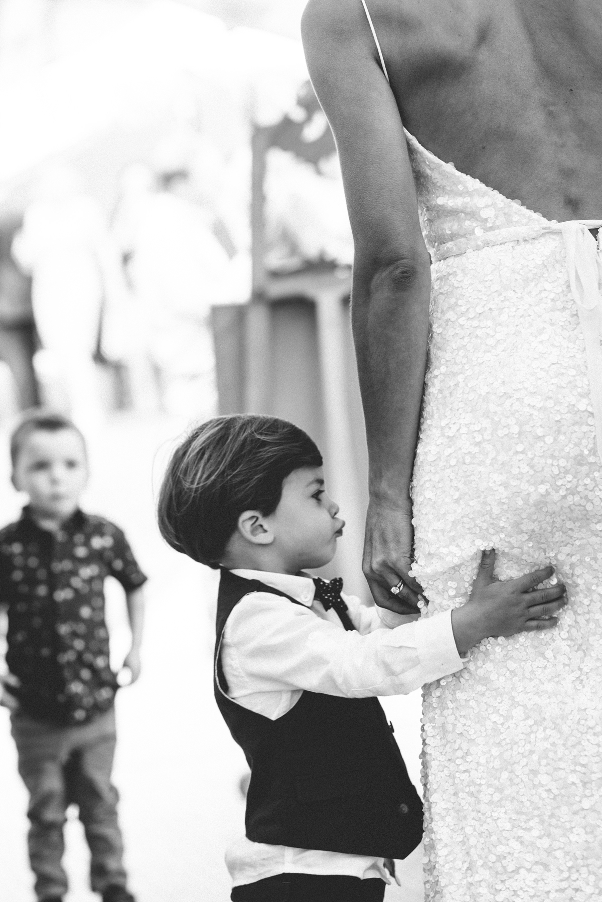 ring bearer holding onto bride