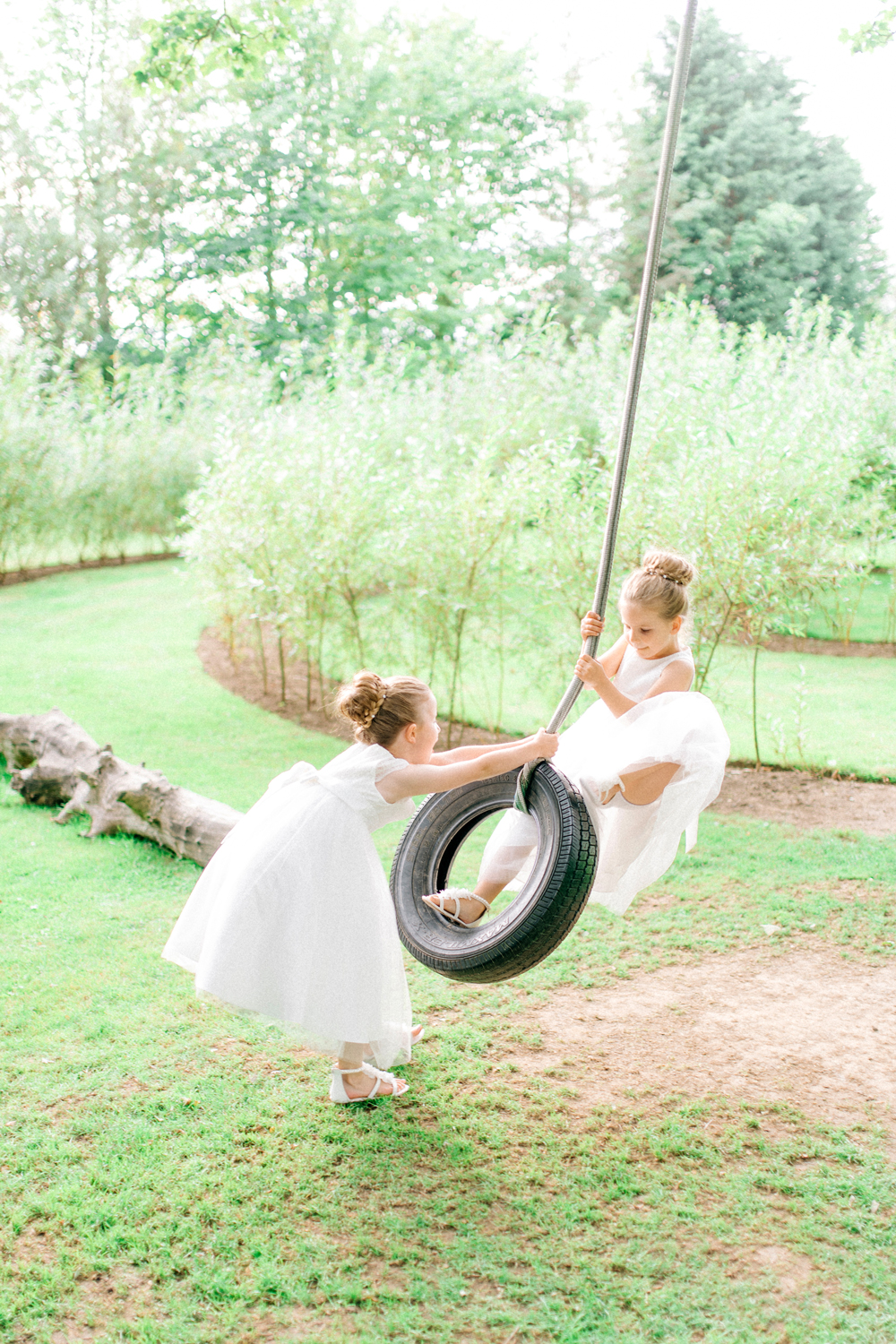 flower girls on tire swing