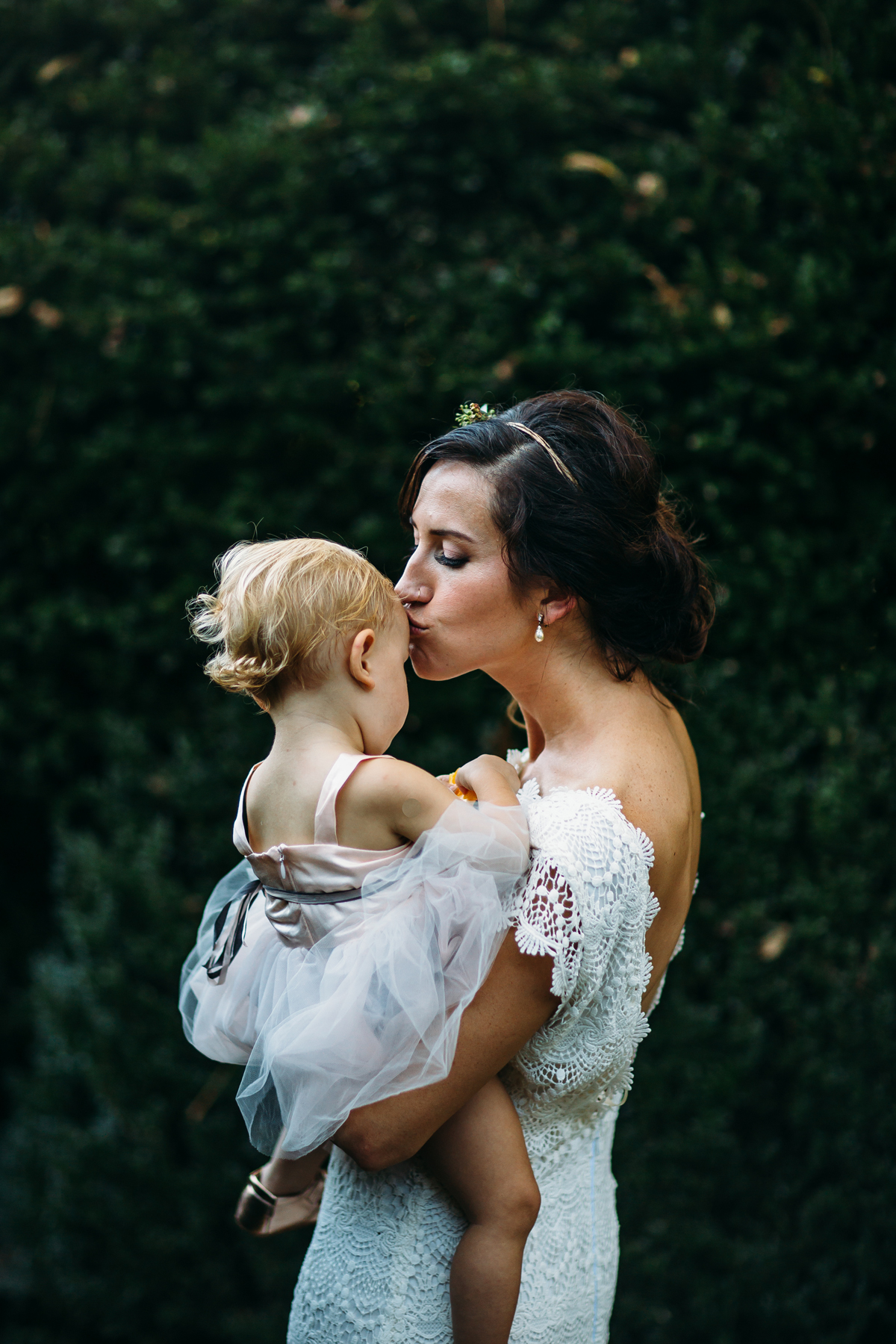 bride kissing baby