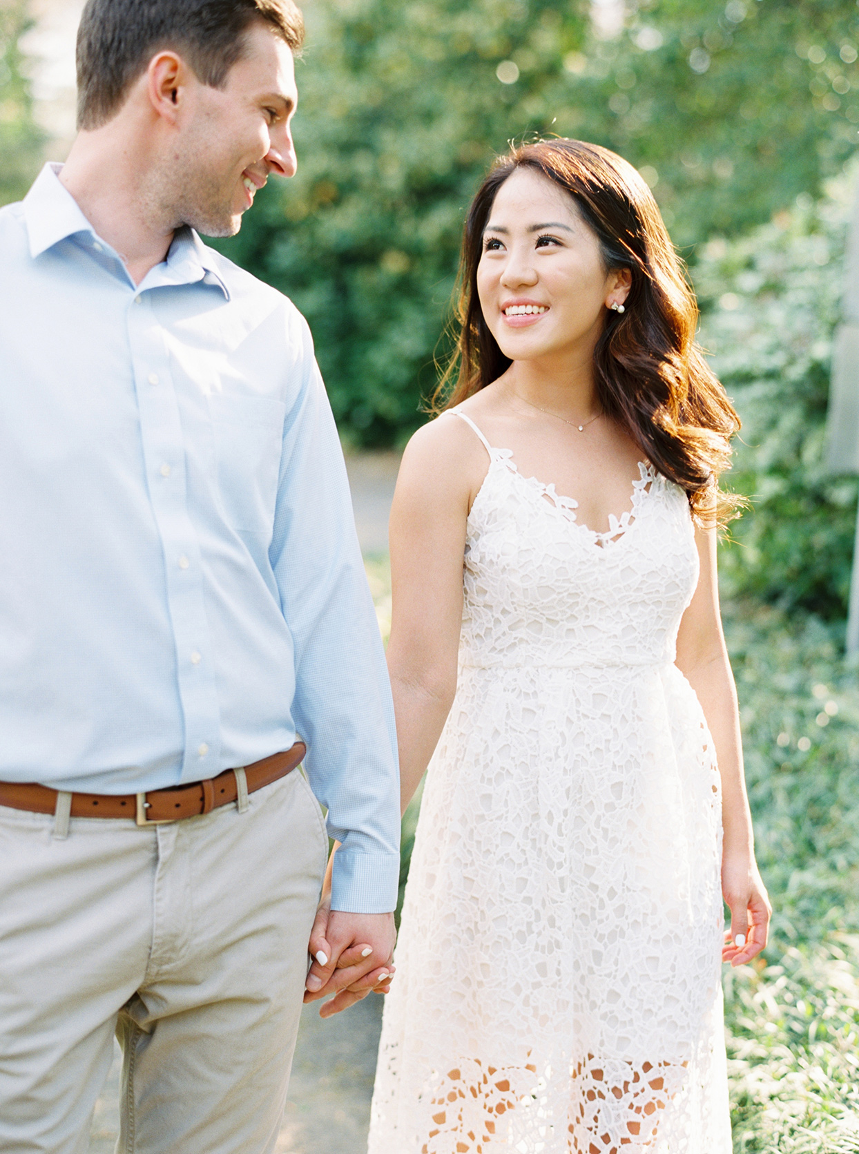bride in white lace brunch attire and groom in light blue shirt