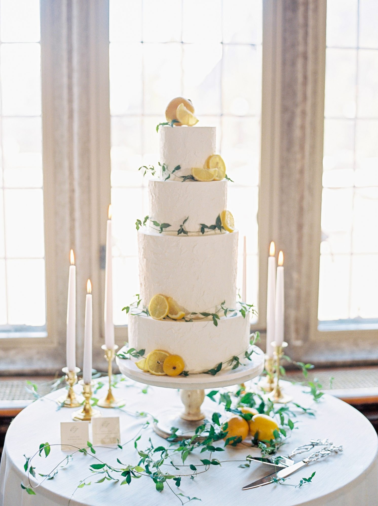 4-tier cake decorated with greenery and lemons