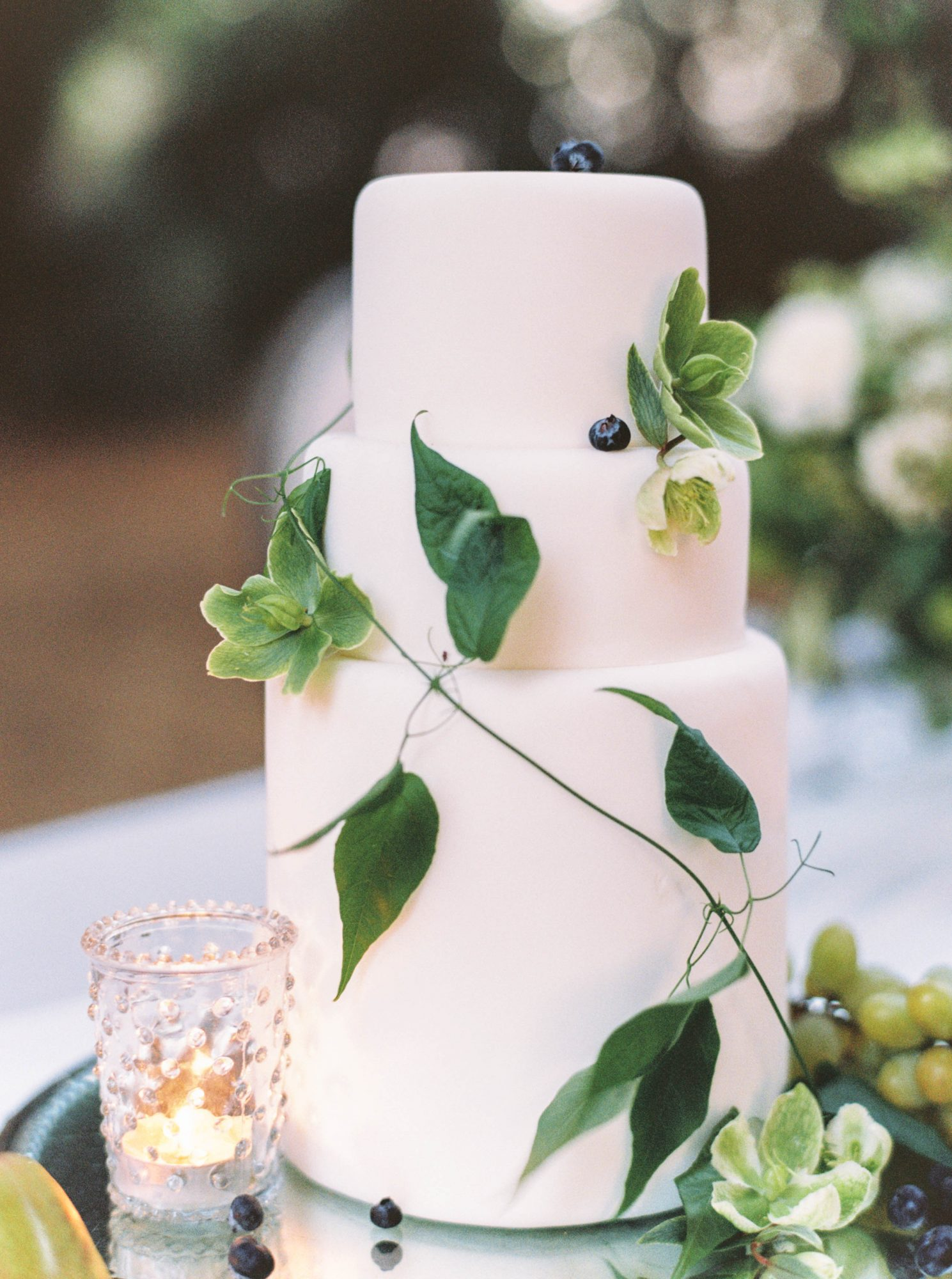 3-tier white cake wrapped in leafy vine