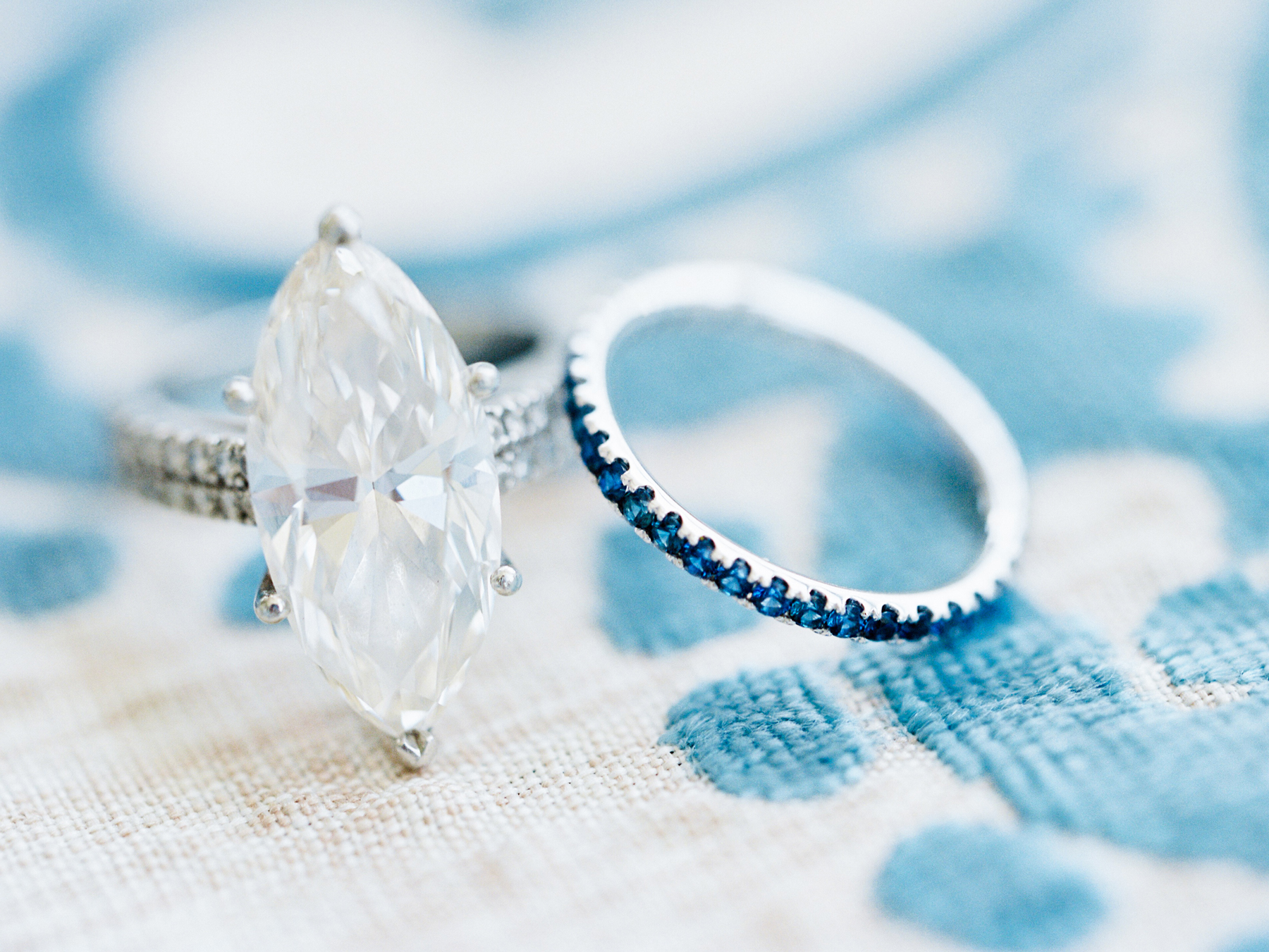 engagement rings marquise rock accompanied with blue stone set band