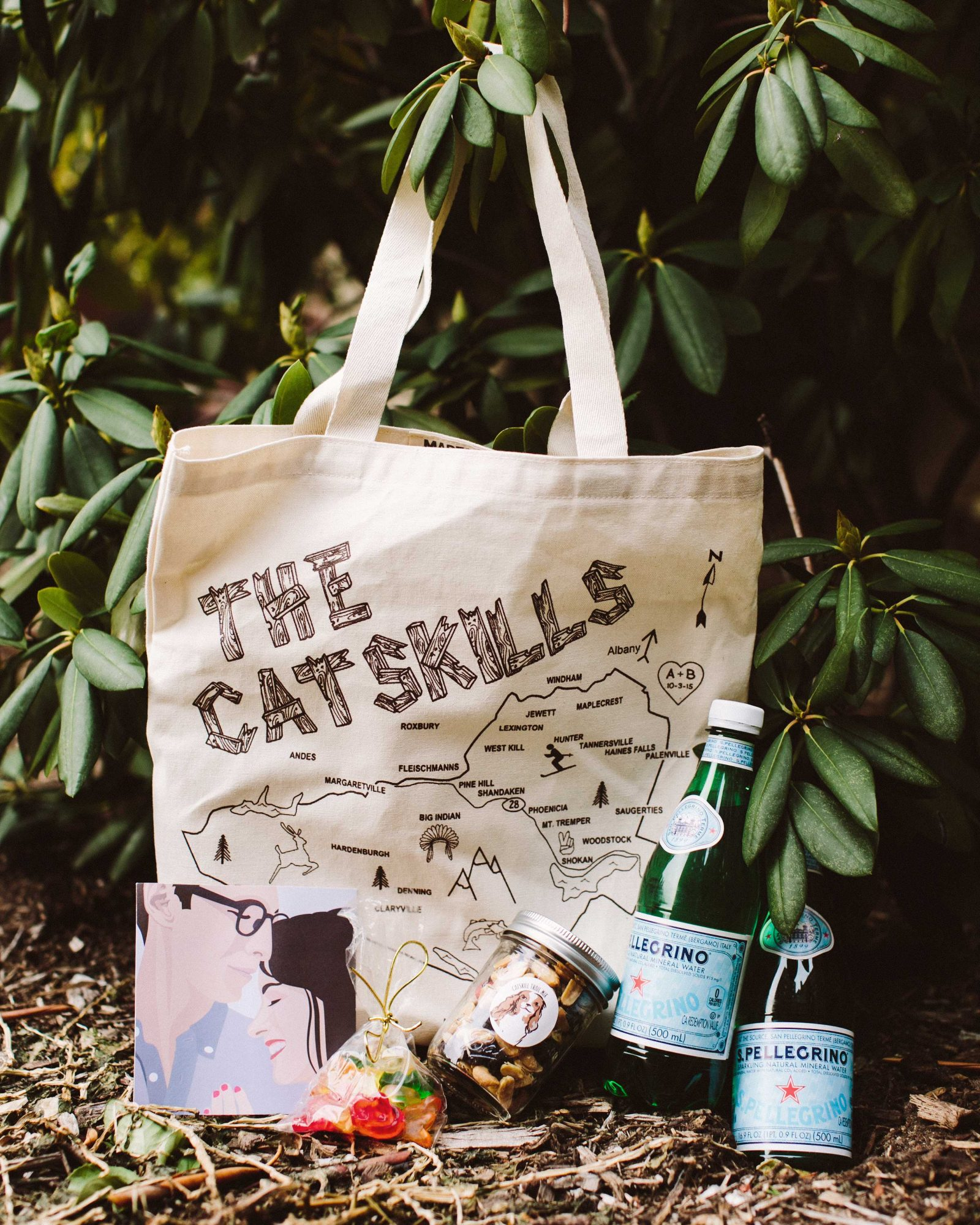 Guests were given custom Catskill totes from Maptote, filled with water, trail mix, gummies, and hangover aids. Included in the bag was a card created by Barrett's graphic designer sister inspired by one of the pair's engagement photos, with a schedule of events on the back.
