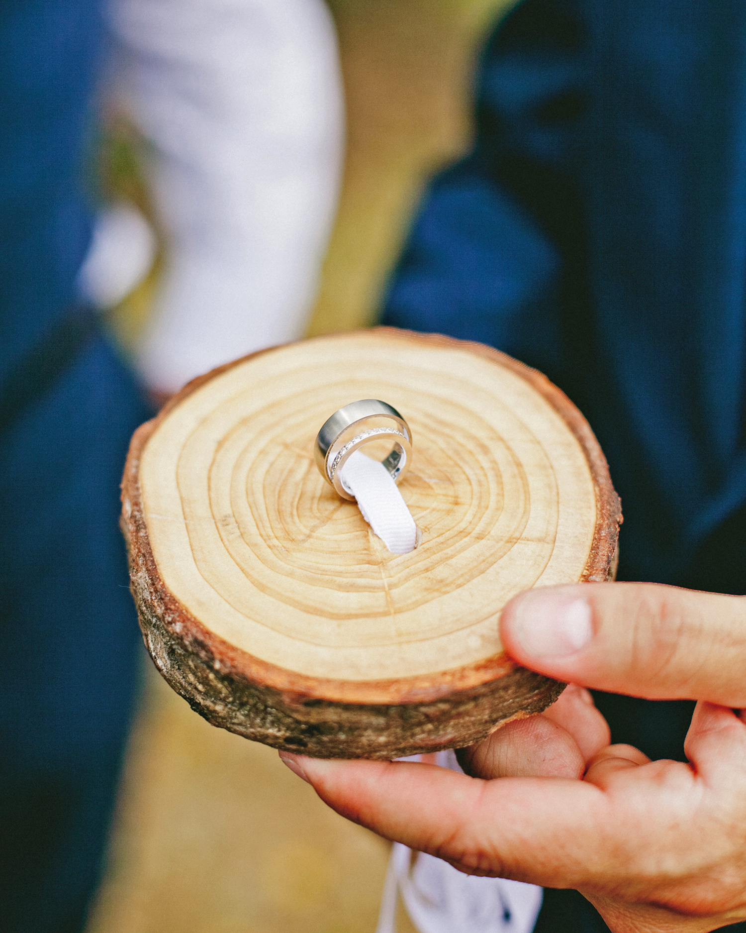 wedding rings tied to a block of wood