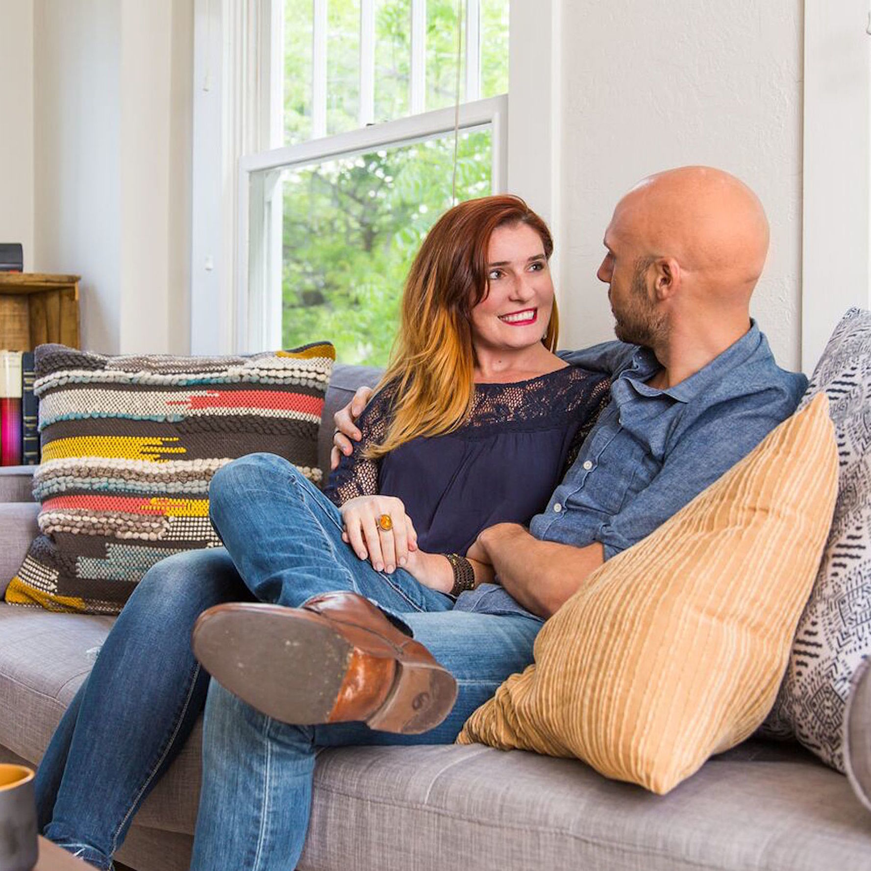 couple looking at each other on couch