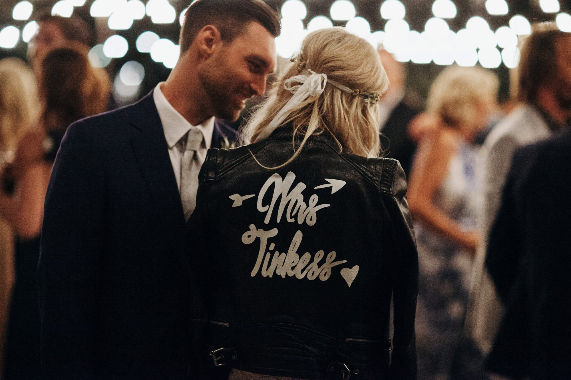 mrs. black leather jacket just married couple