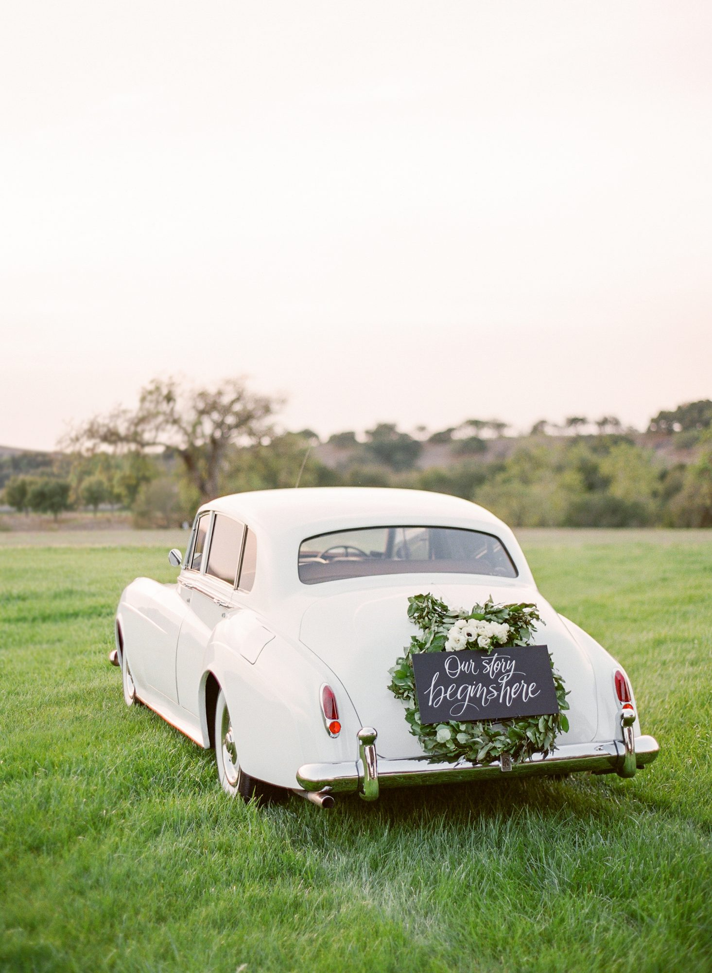 just married sign white classic car our story begins here