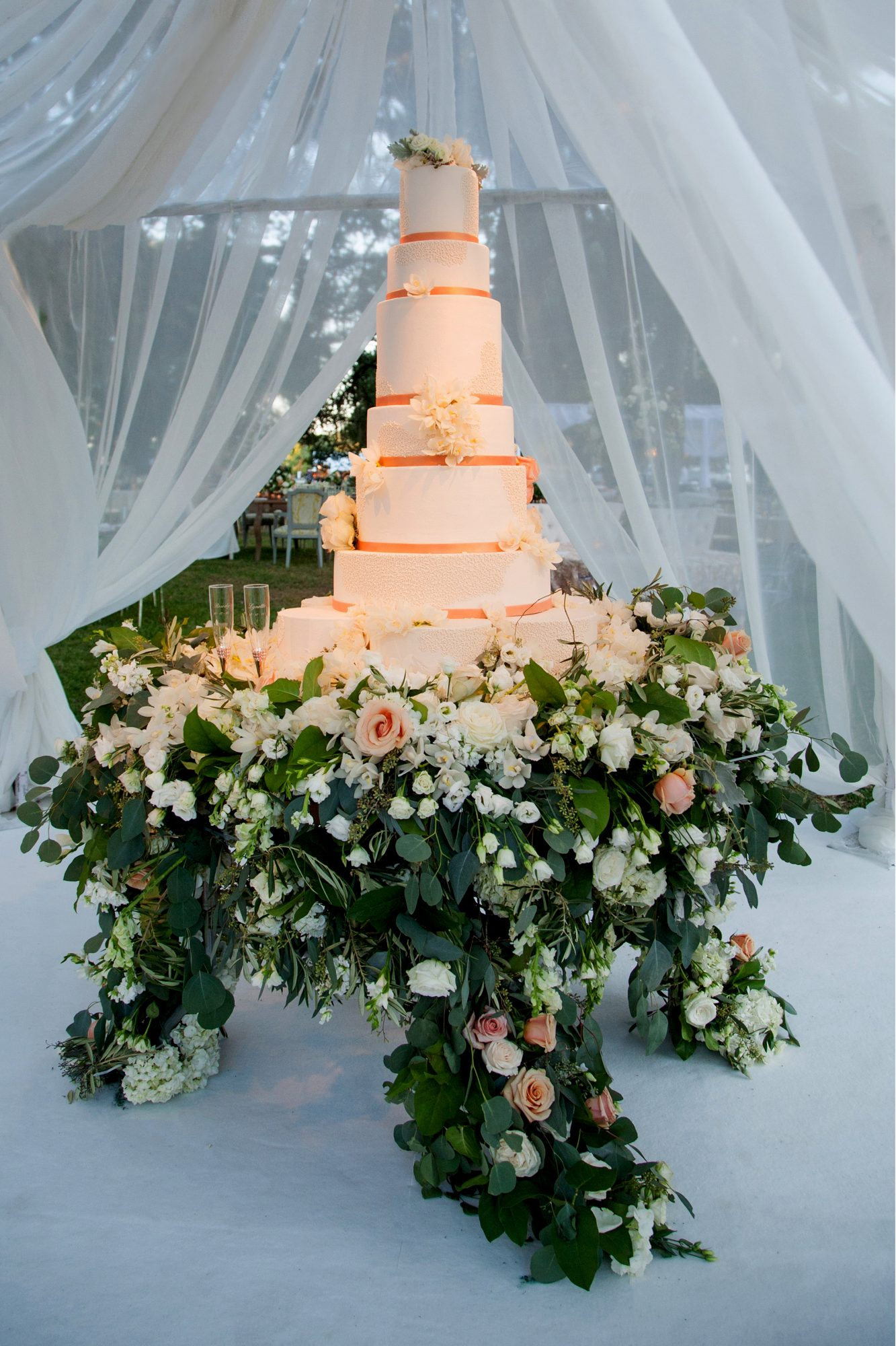 large wedding cake on floral base