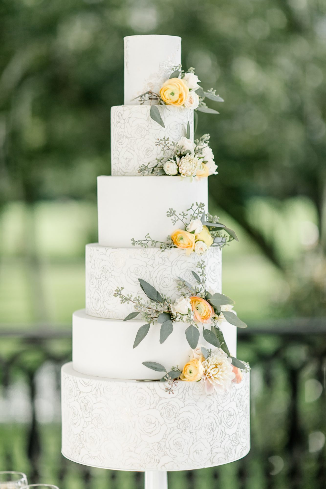 large wedding cake with printed tiers