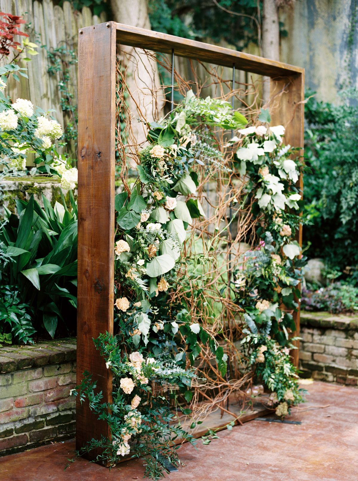 wedding plant wall floral arch attached to wood frame