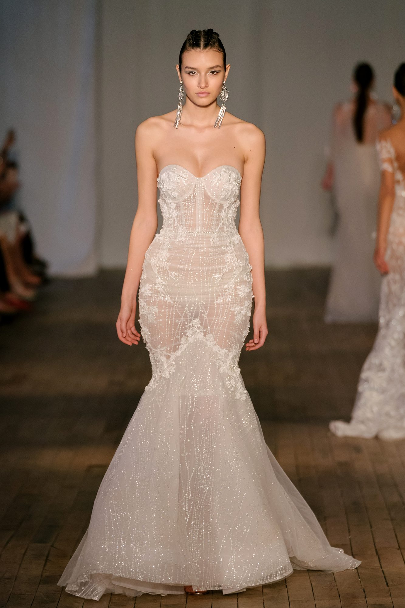 Sheer trumpet wedding dress with strapless neckline and floral appliqués