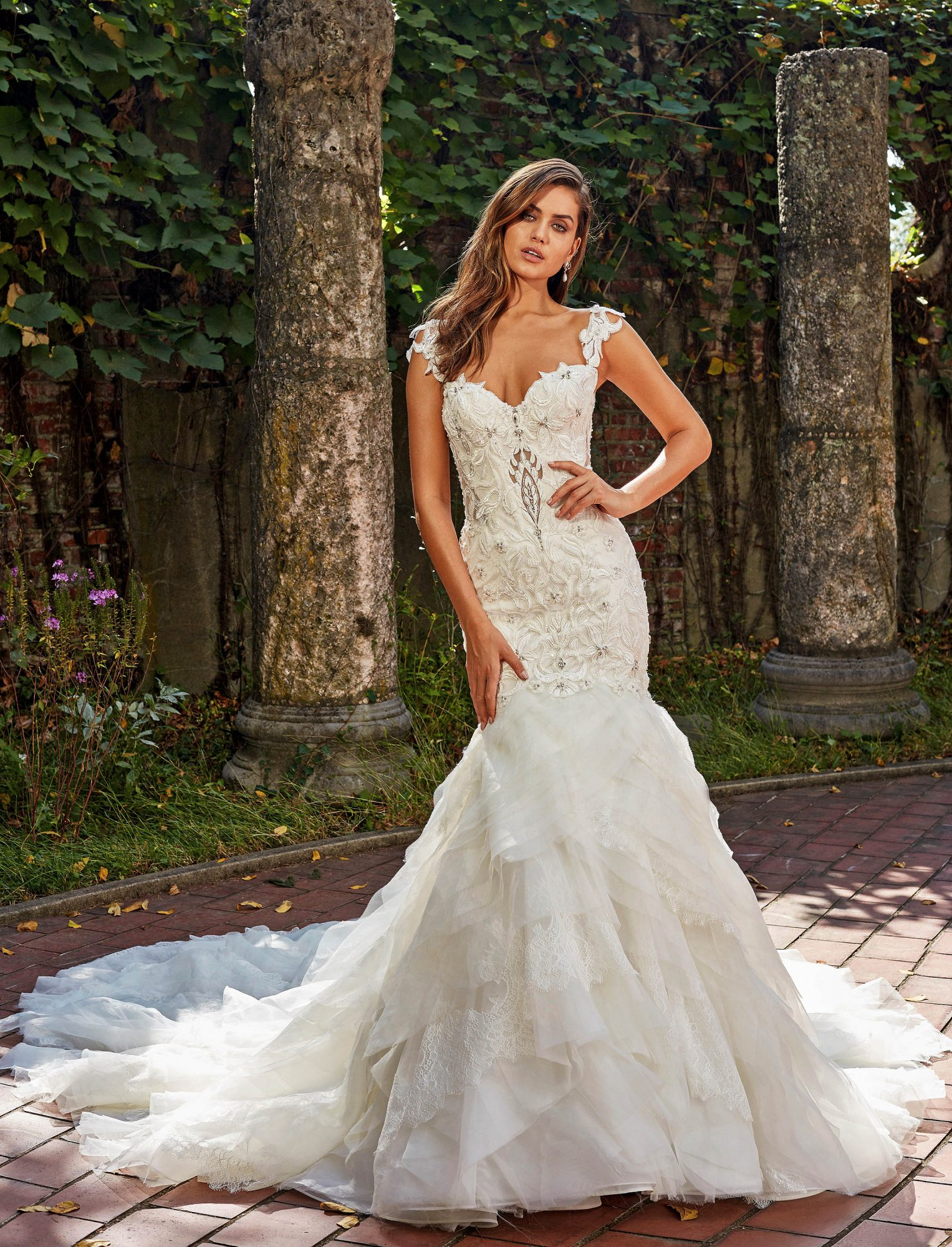 Lace mermaid wedding dress with sweetheart neckline and layered skirt