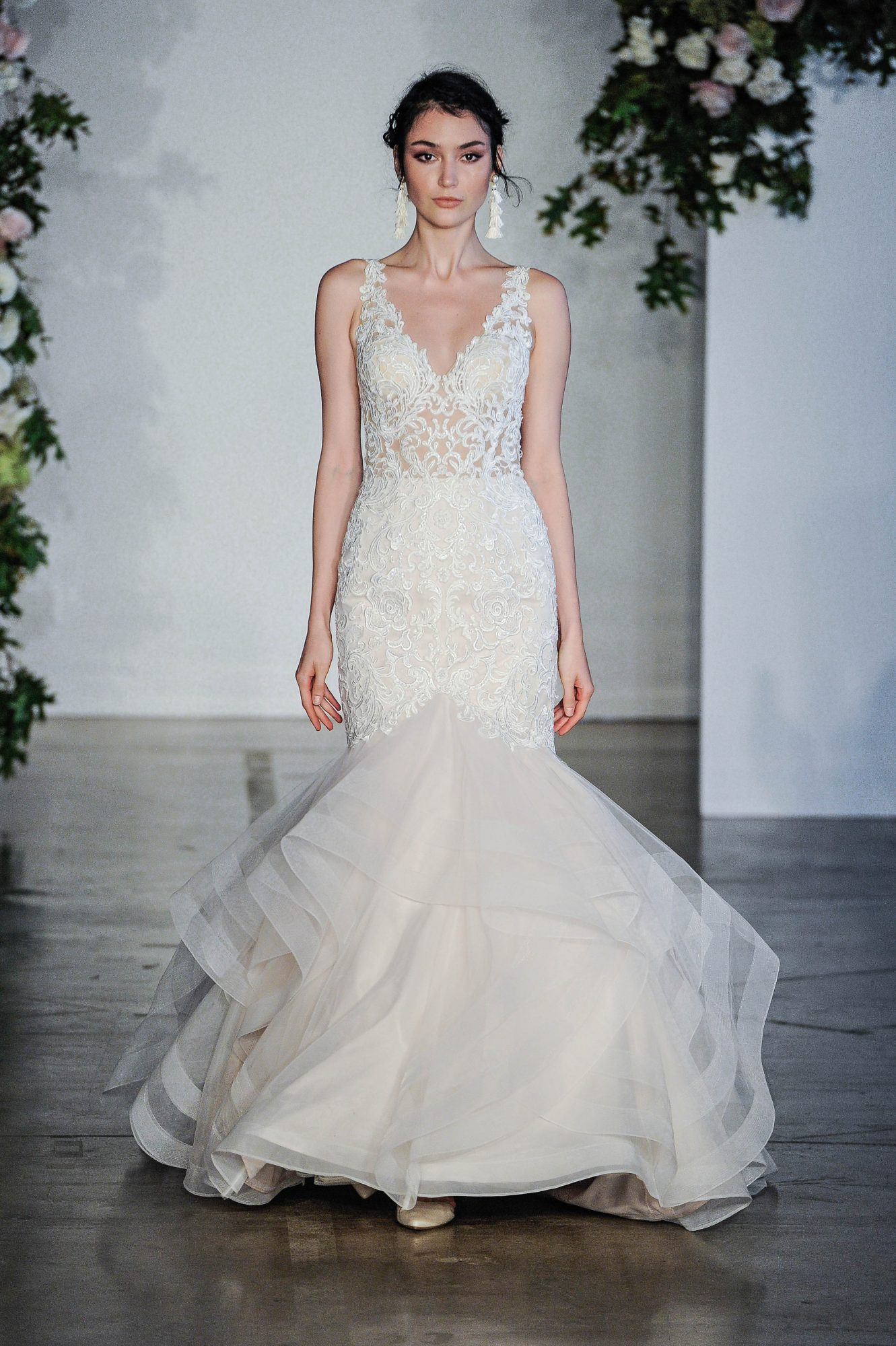 Sleeveless trumpet wedding dress with V-neckline and sheer top