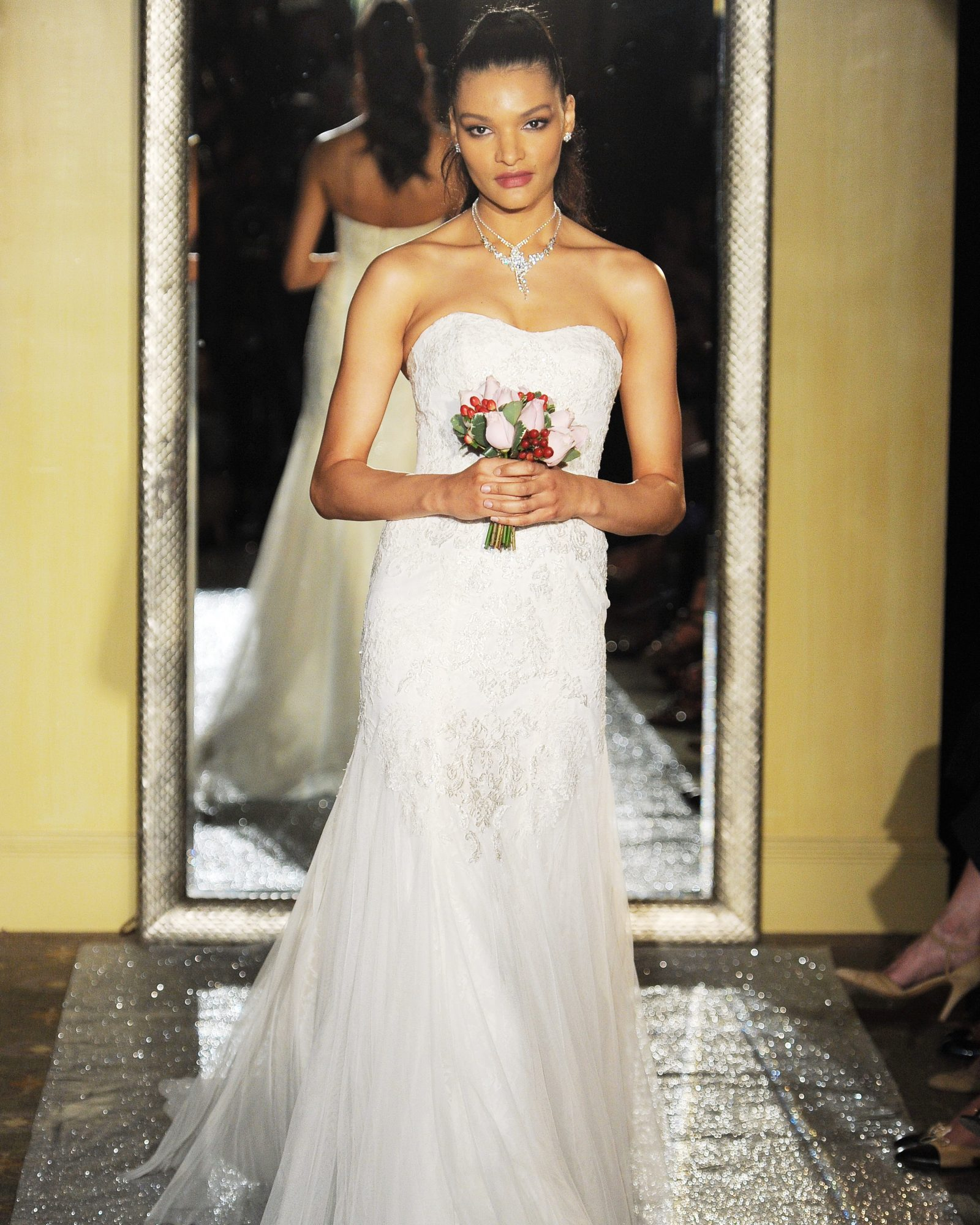 Ivory tulle mermaid gown with layers of lace and beaded appliqué.