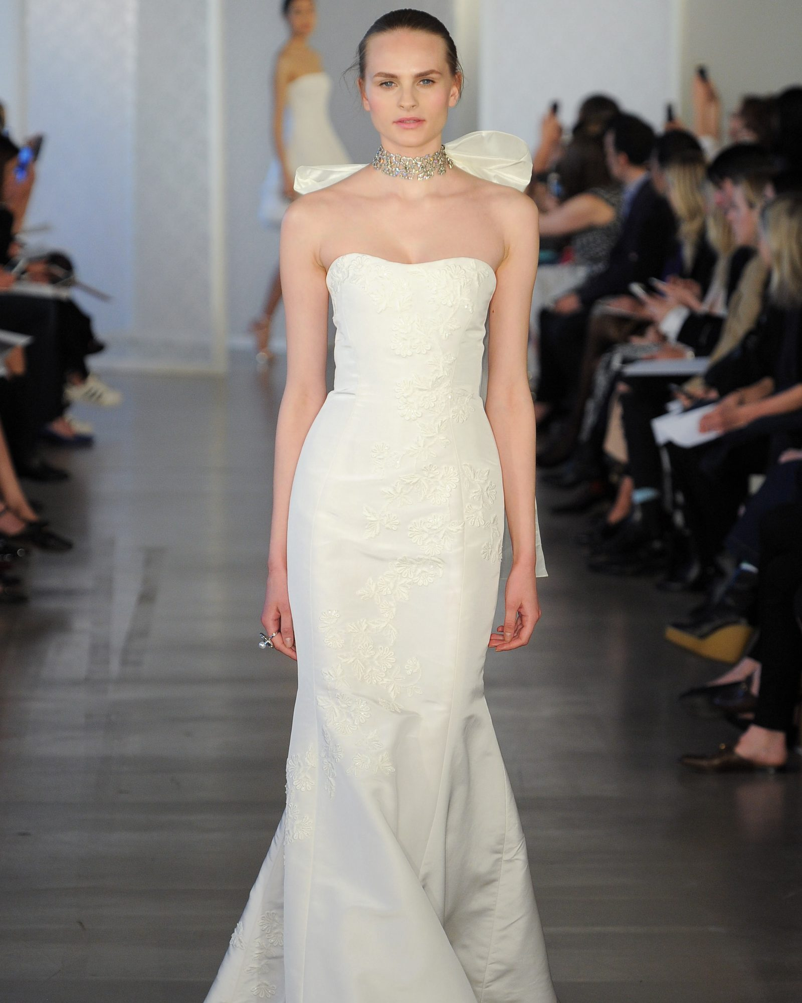 Ivory silk faille trumpet gown with guipure embroidery.
