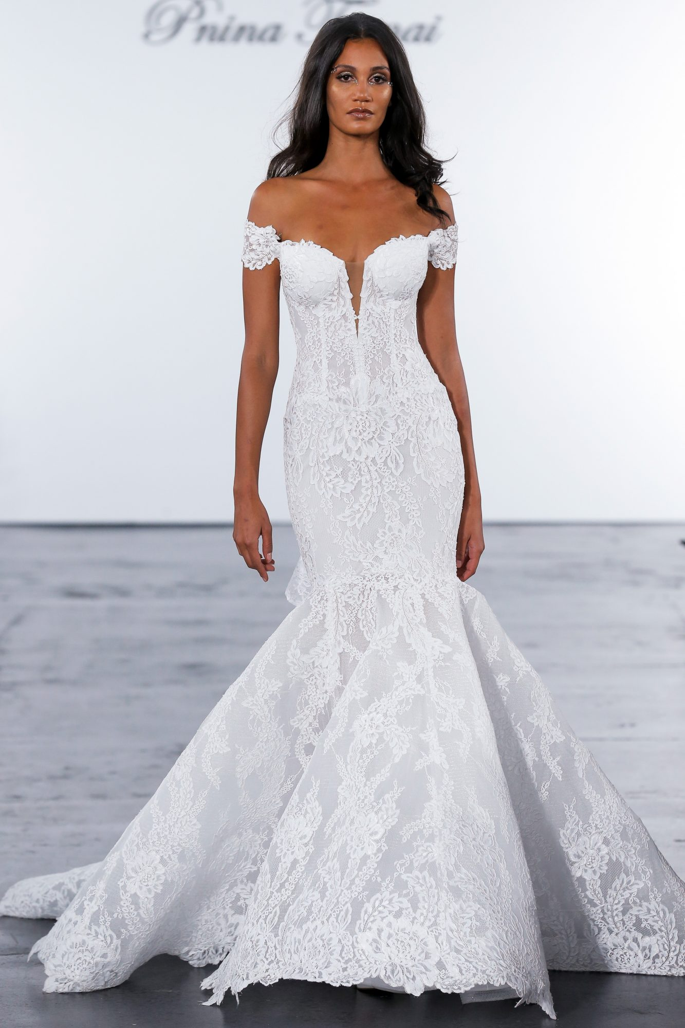Off-the-shoulder lace wedding dress with trumpet skirt