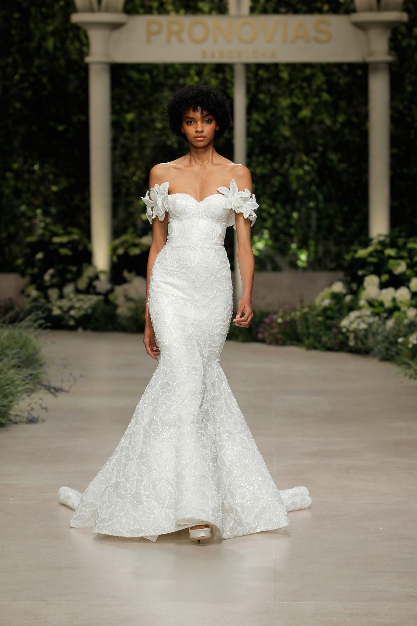 Trumpet wedding dress with off-the-shoulder neckline and floral elements
