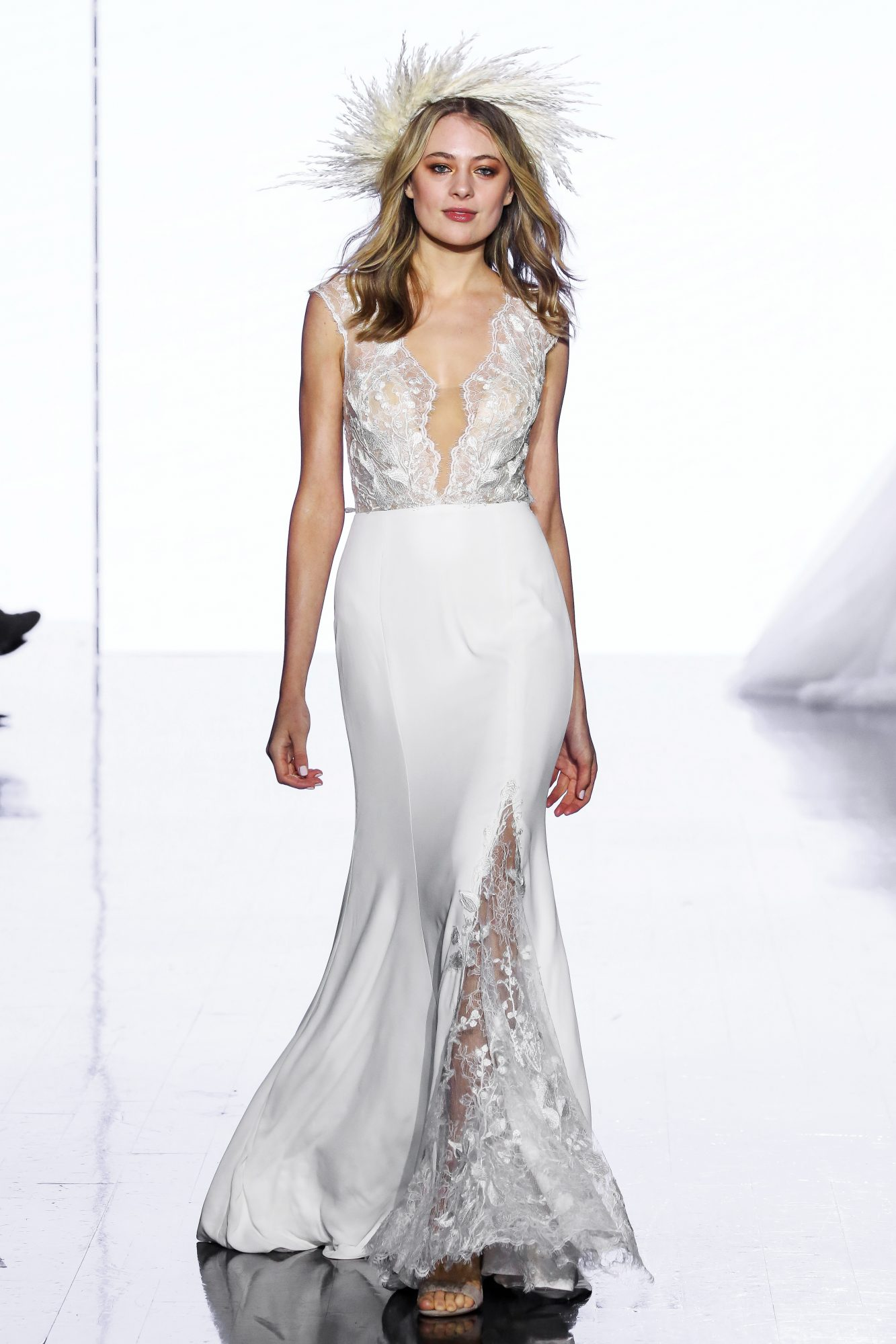 Mermaid wedding dress with deep V-neckline, floral embroidery, illusion cut out, cap sleeves, and slit