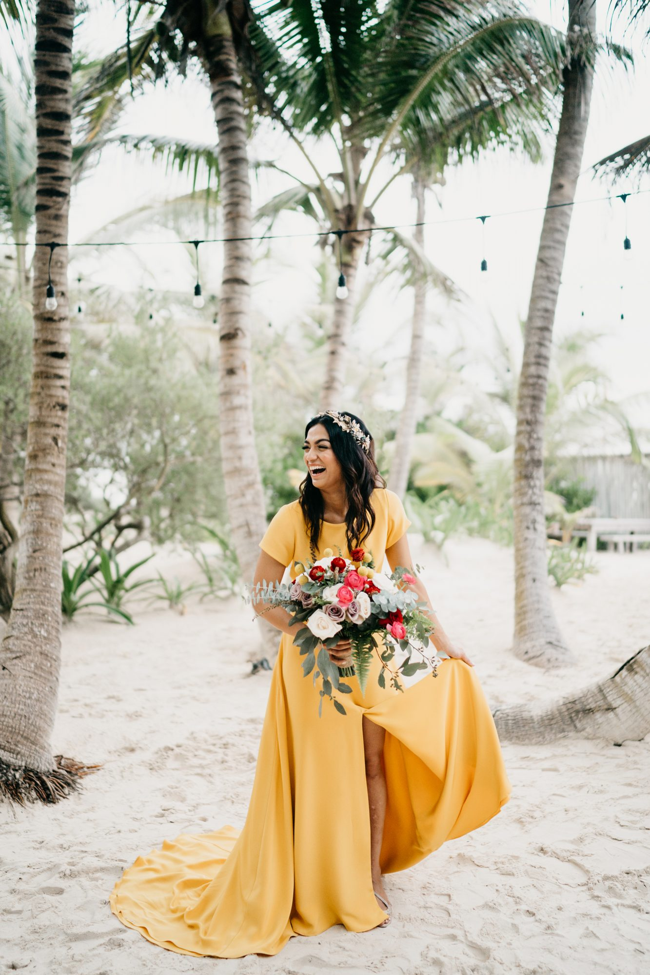 beach wedding dresses bride in yellow dress under palm trees