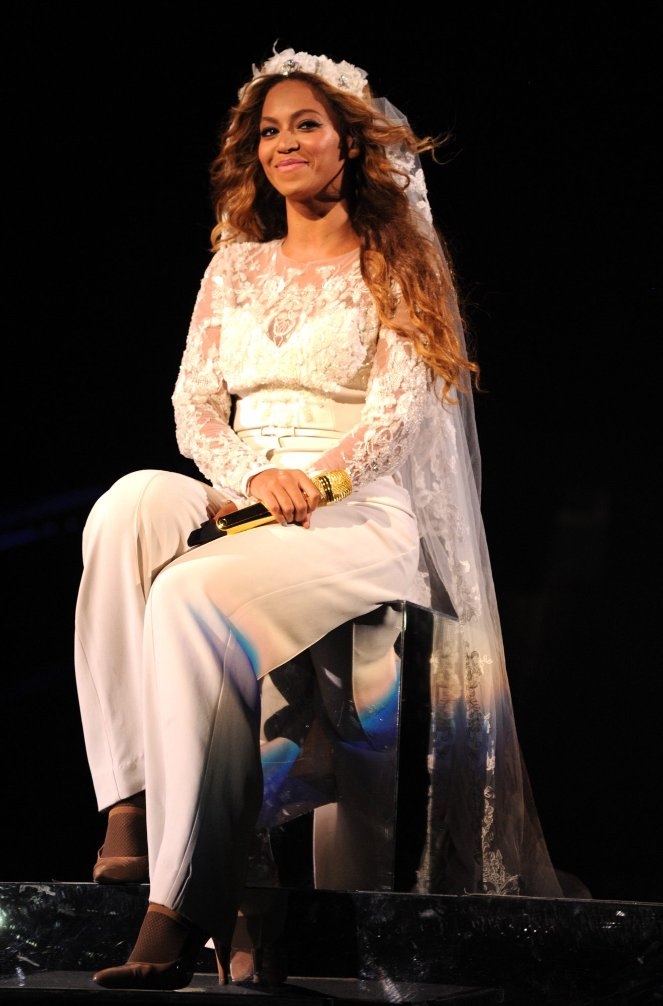 Beyoncé wearing a bridal jumpsuit during her On the Run tour