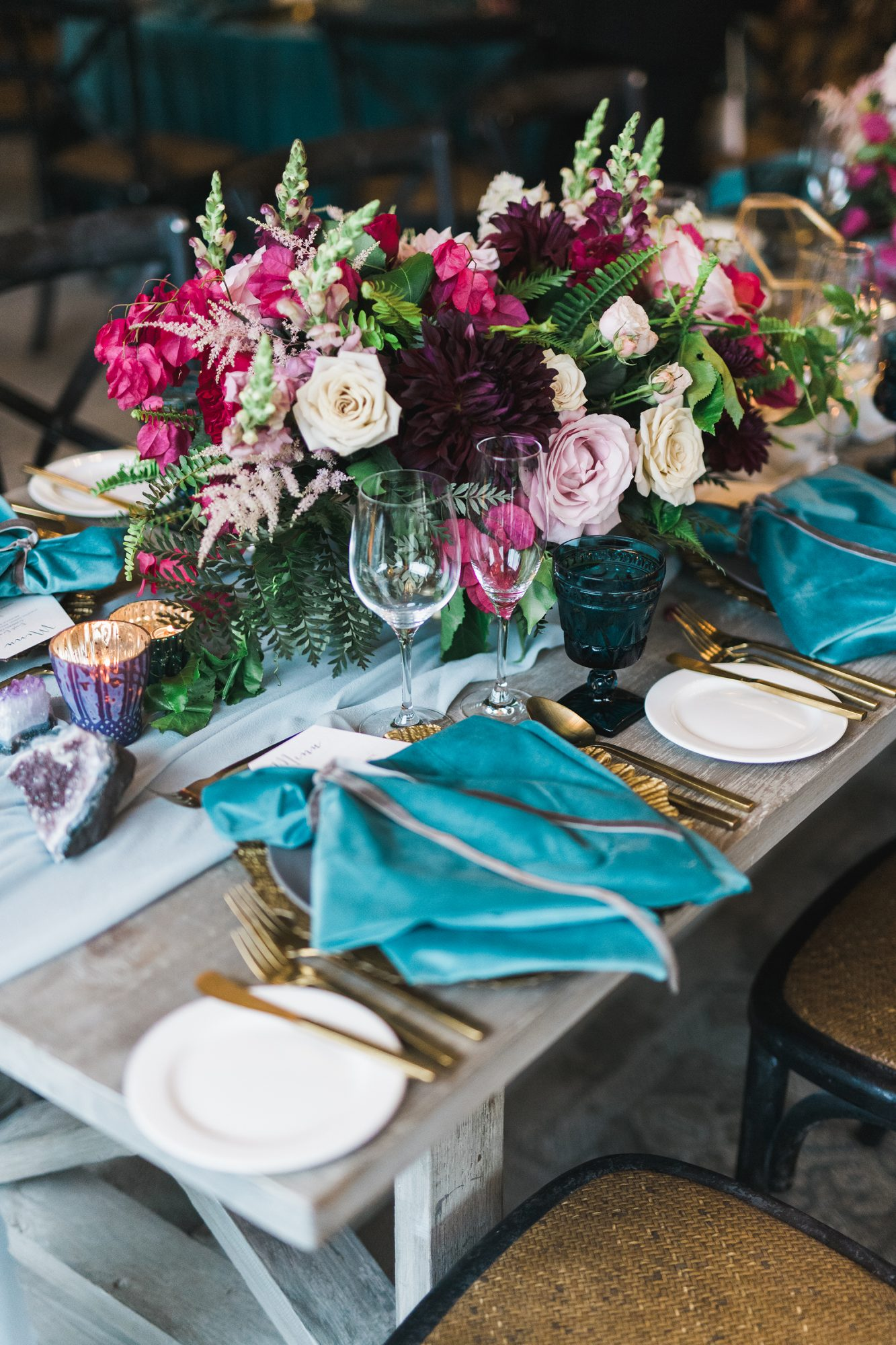 jewel-toned centerpiece with garden roses and dahlias