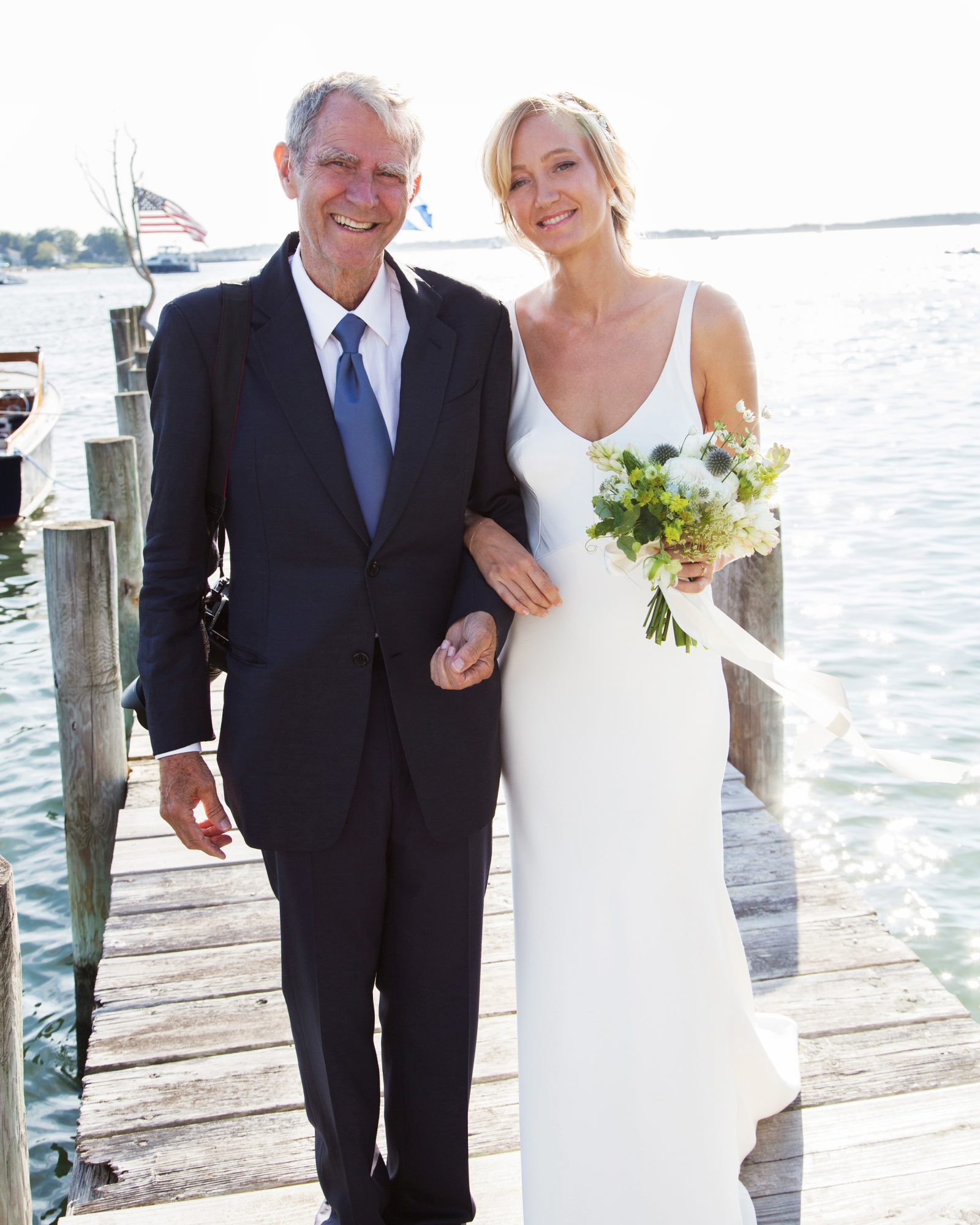 bride with father outdoor dock