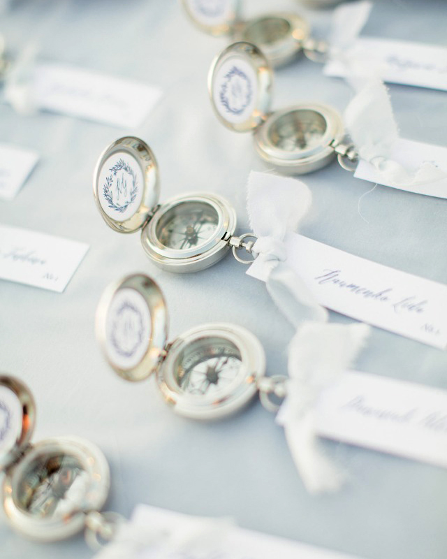 """Nothing says """"nautical seaside wedding"""" like compassfavors. These ones doubled as escort cards and featured Atelier Invitations calligraphy."""