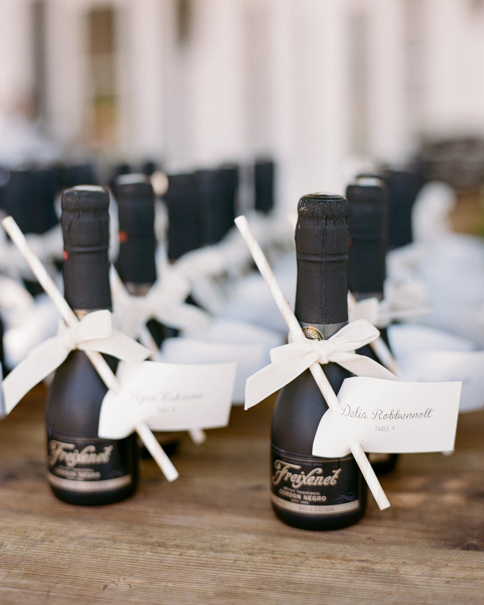 This couple sent celebrants home from their vineyard wedding with mini bottles of Freixenet wine.