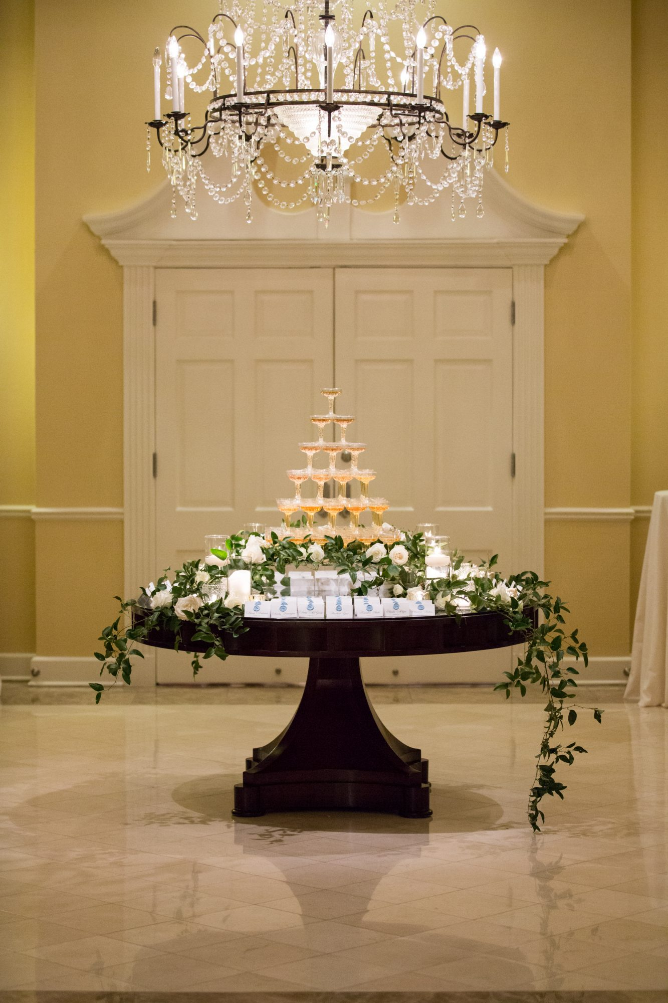 champagne tower on escort card table
