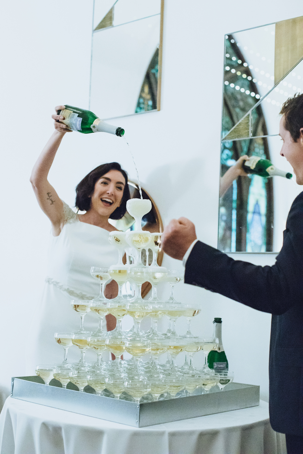 wedding champagne towers bride and groom pouring