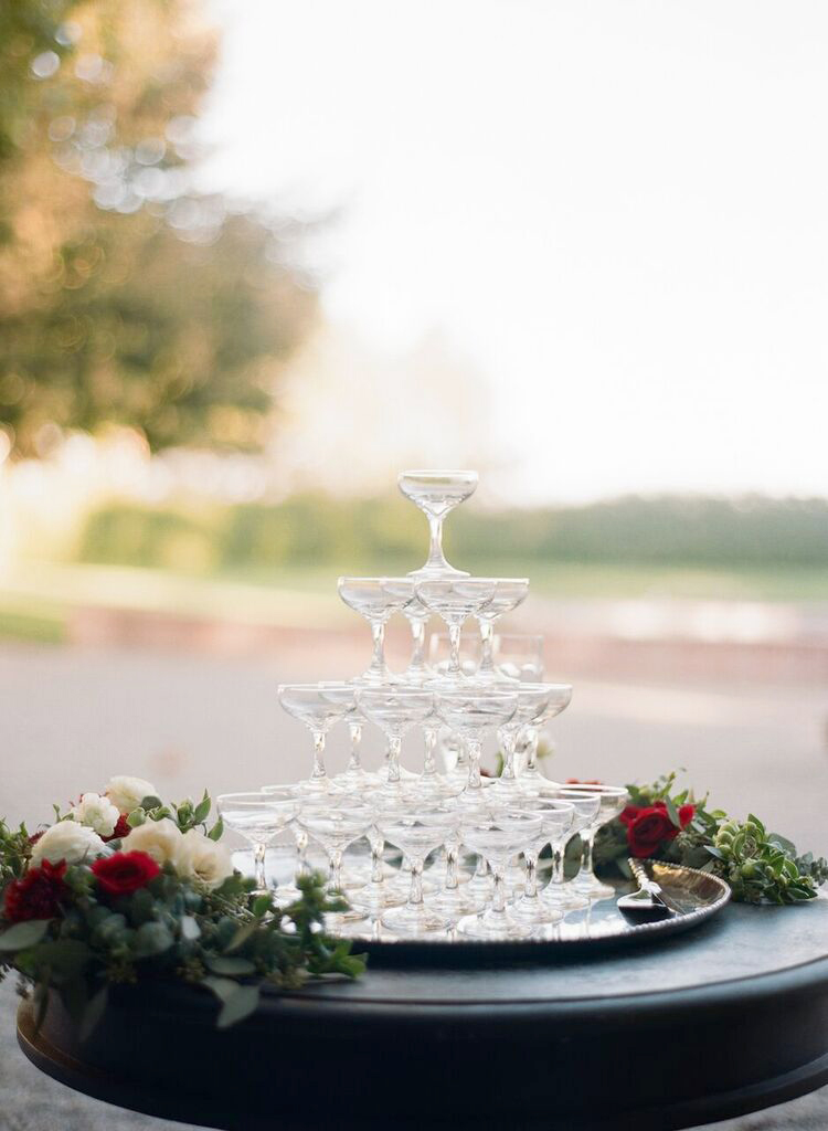 wedding champagne towers on silver platter with roses