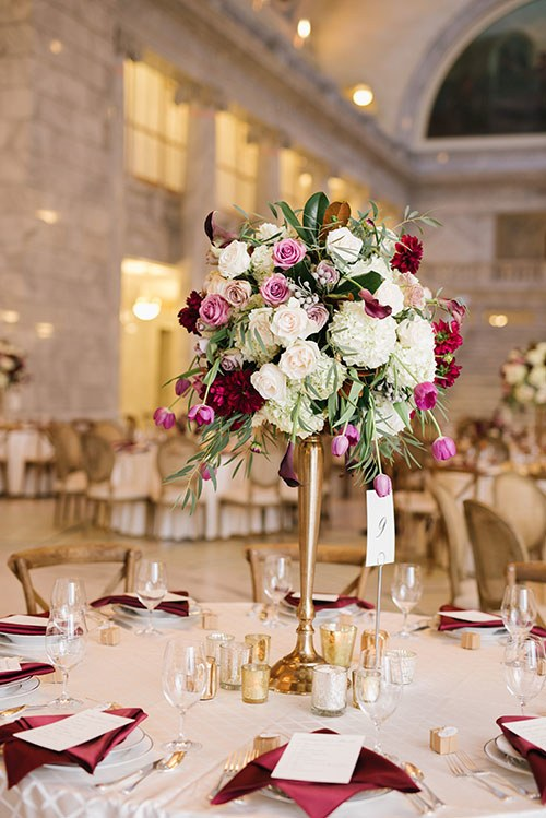 tall centerpiece with hydrangeas and garden roses