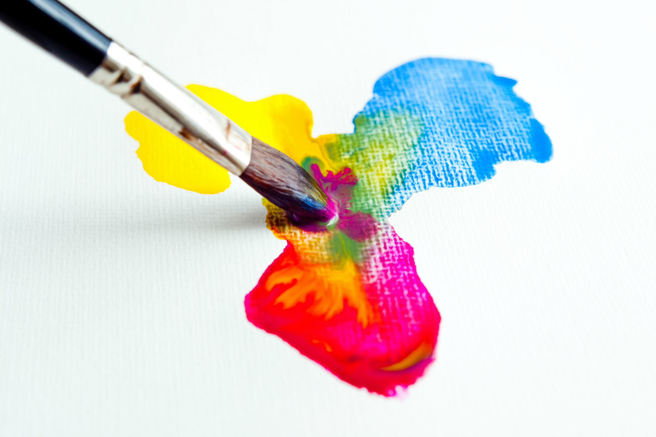 A paintbrush mixing watercolors