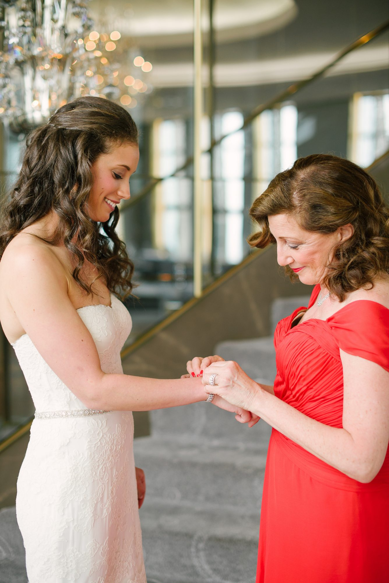 A Mom Helping Her Daughter with Her Wedding Jewelry