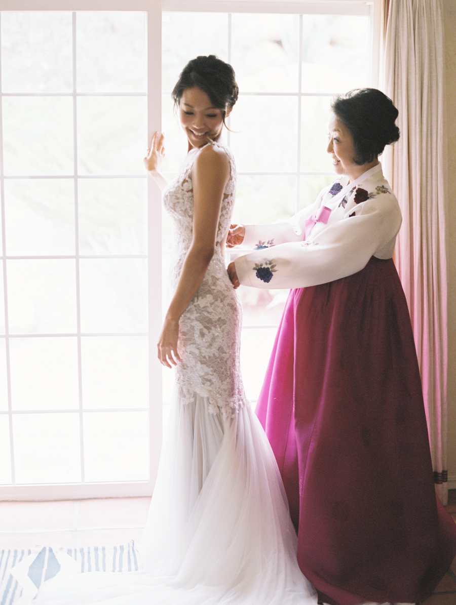 Mother Helping Her Daughter with Her Wedding Dress