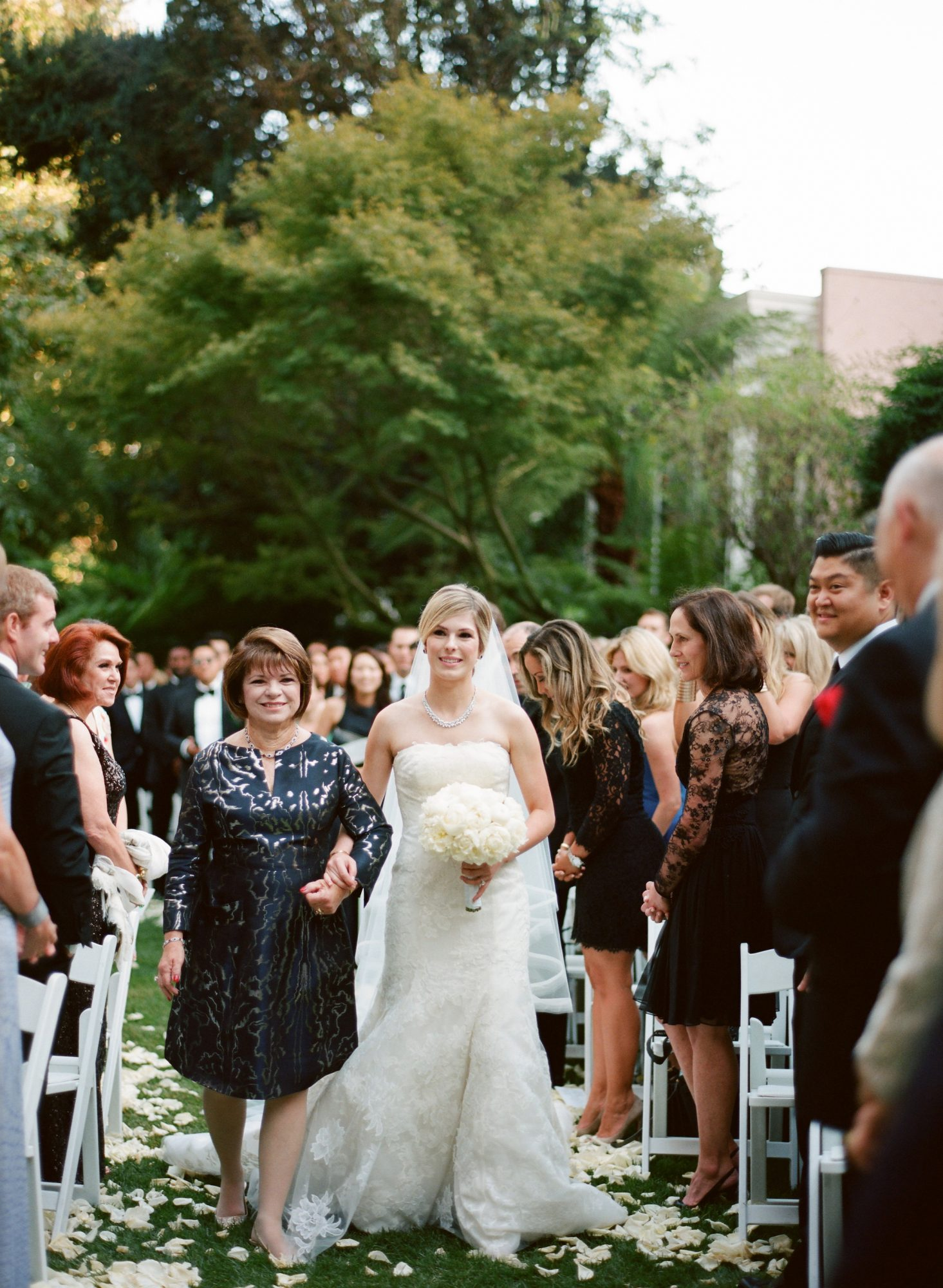 A Bride Walking Down the Aisle with Her Mother