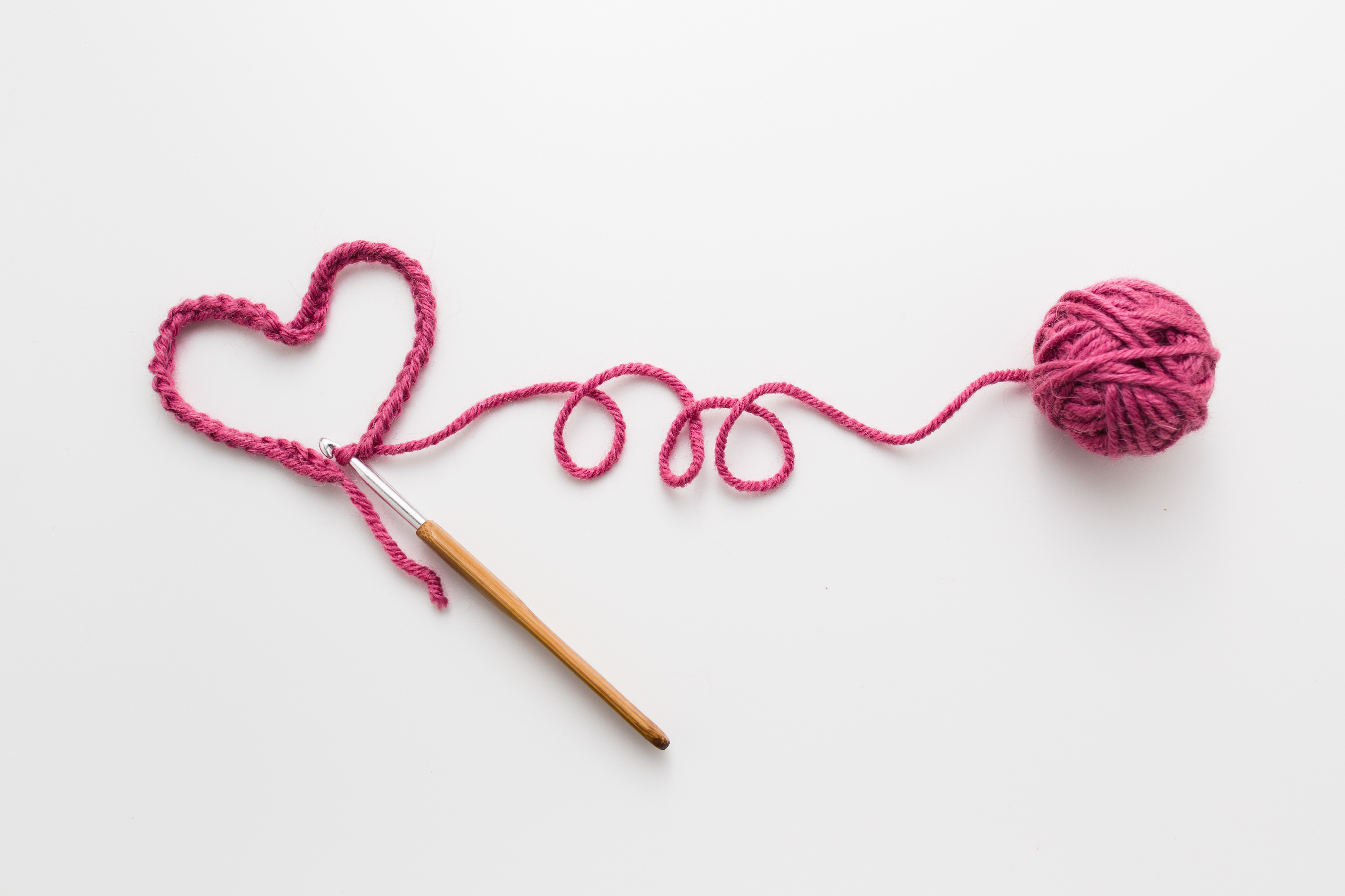 pink yarn crocheted into a heart