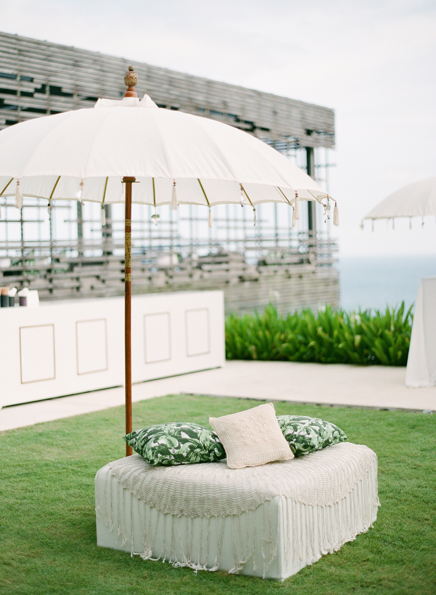 wedding lounge umbrella over white chair