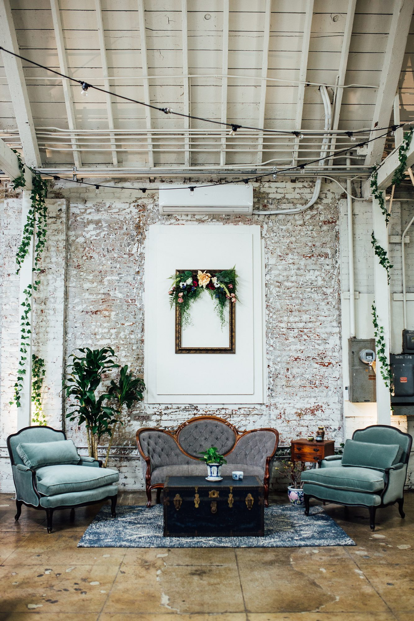 wedding lounge victorian couches and antique chest coffee table
