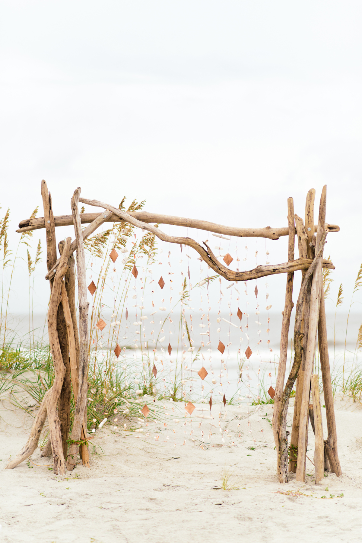 rose gold wedding ideas driftwood ceremony arch with streamers