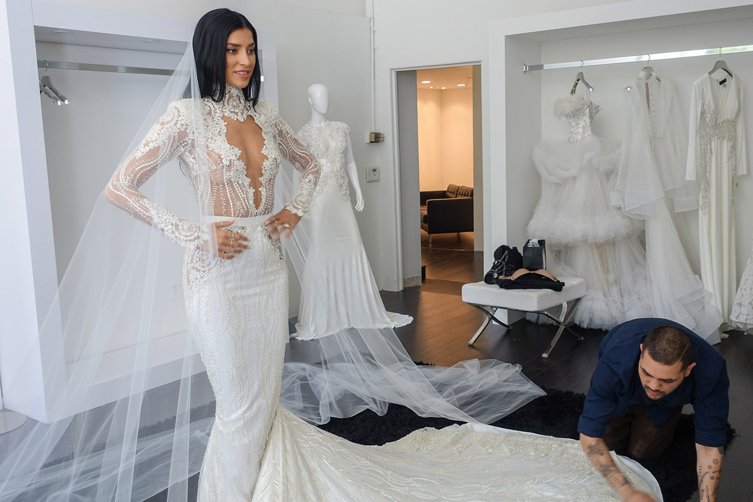 Nicole Williams in her wedding dress and veil by Michael Costello