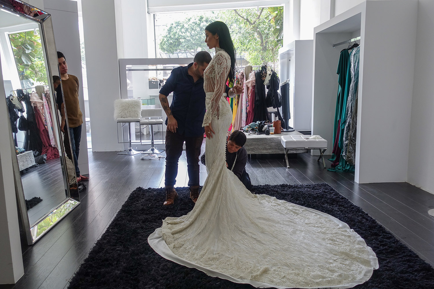 Nicole Williams wedding dress with long train by Michael Costello
