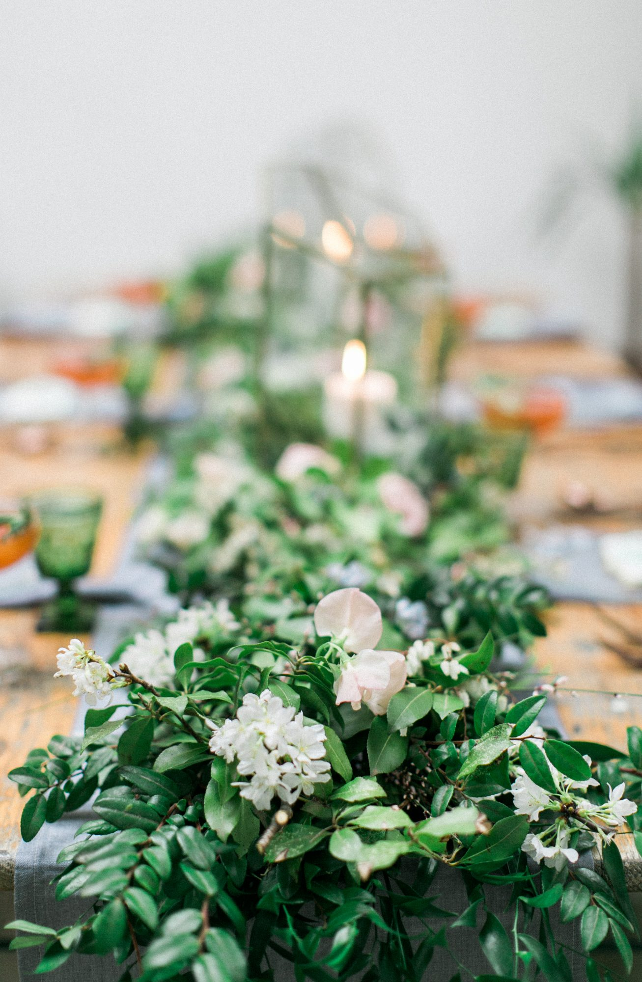 cascading centerpiece with candles and greenery