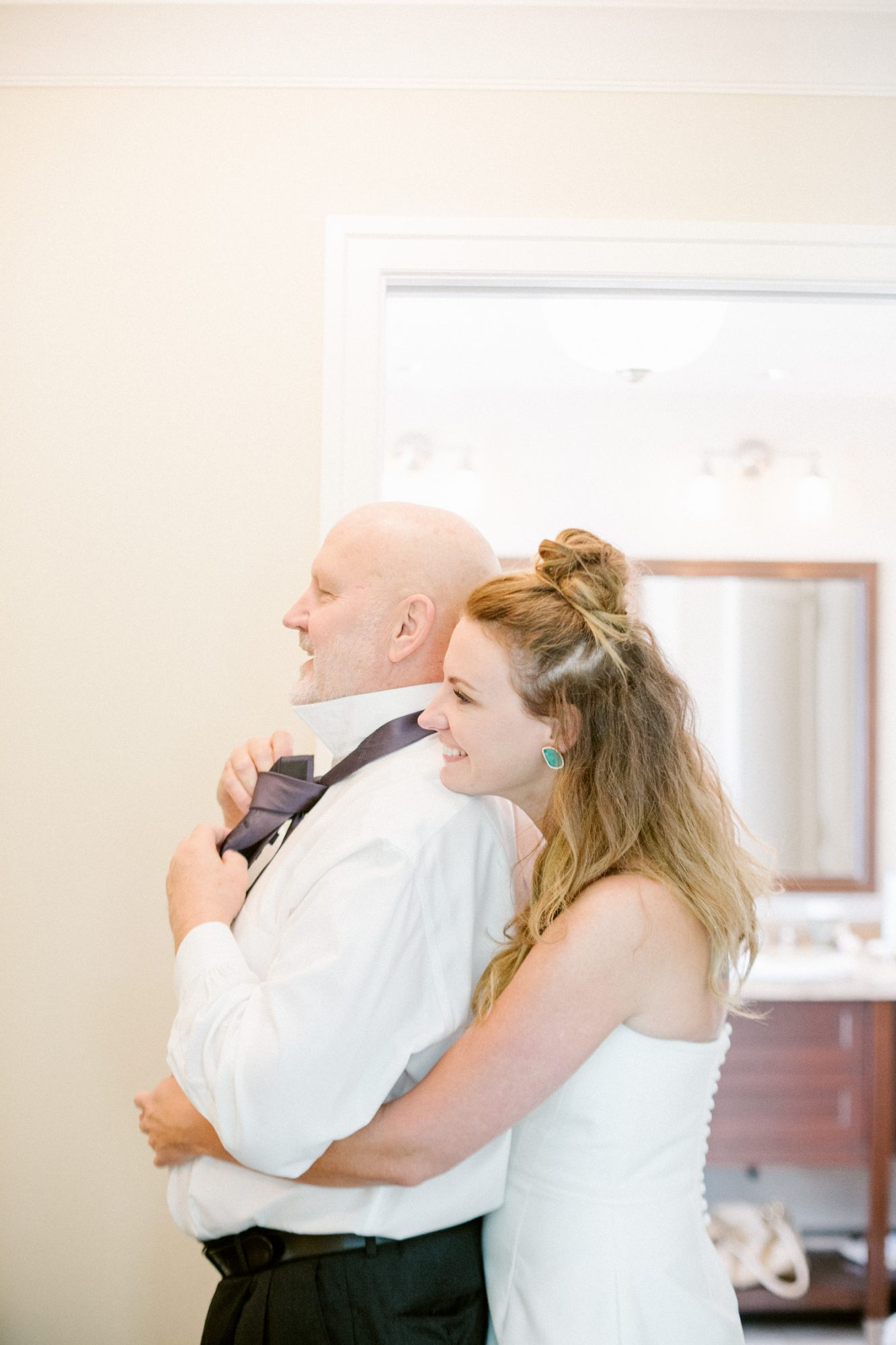 father daughter hugging wedding moment