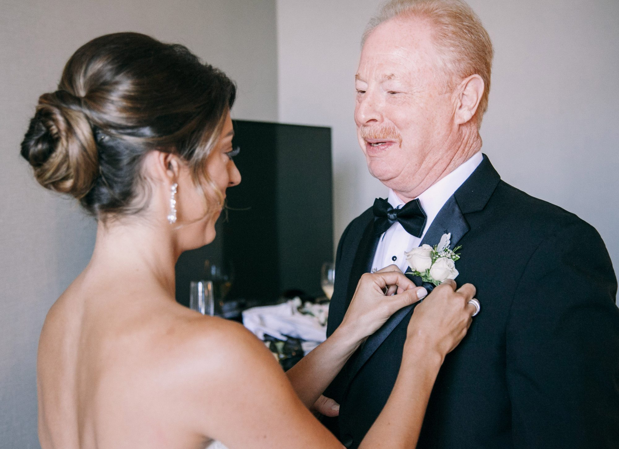 dad daughter wedding moment pinning boutonniere