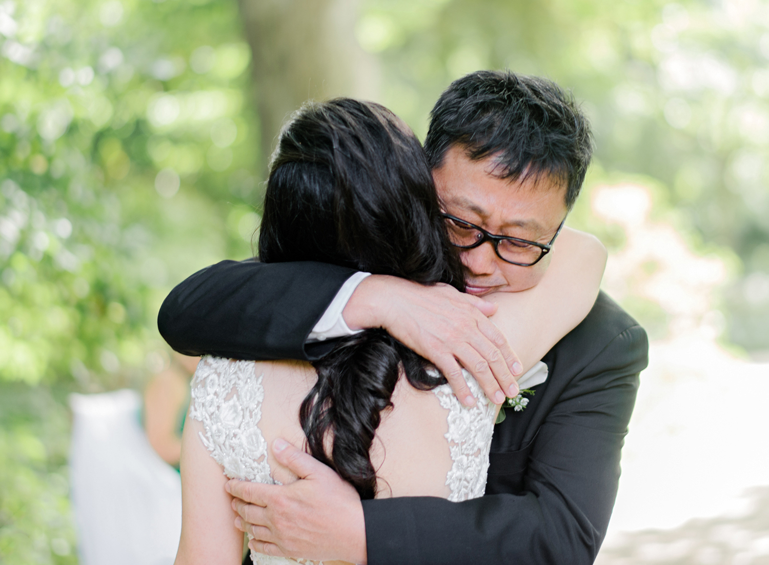 bride and father embrace outside